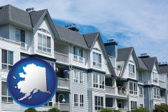 alaska map icon and a residential apartment building